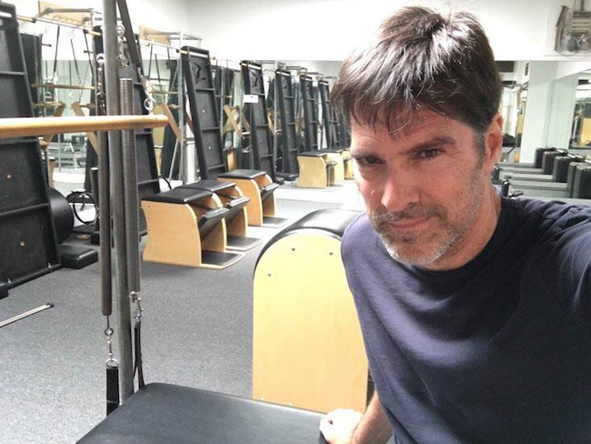 Thomas Gibson shows off a pilates chamber after a workout