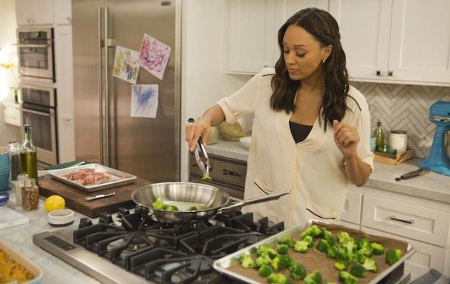 Tia Mowry preparing a Broccoli Saute