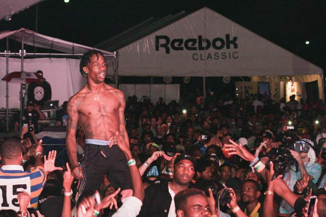 Travis Scott shirtless performing during the Trillectro Music Festival in August 2014