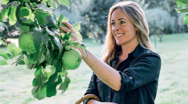 Amelia Freer picking a fruit