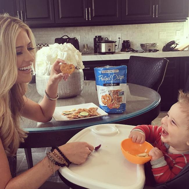 Christina El Moussa and Brayden eating pretzels with hummus