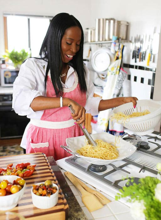 Debbie Solomon cooking food in the kitchen