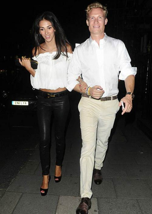 Georgia Salpa and Joe Penna leaving restaurant in Marbella in August 2012