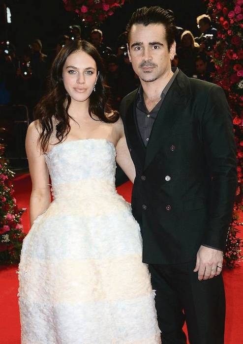"Jessica Brown Findlay with costar Colin Farrell at the ""A New York Winter's Tale"" premiere in February 2014"