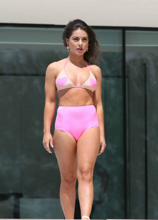 Louise Thompson poses for a calendar bikini shoot in September 2014