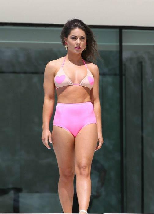 Louise Thompson poses for a calendar bikini shoot in September 2014