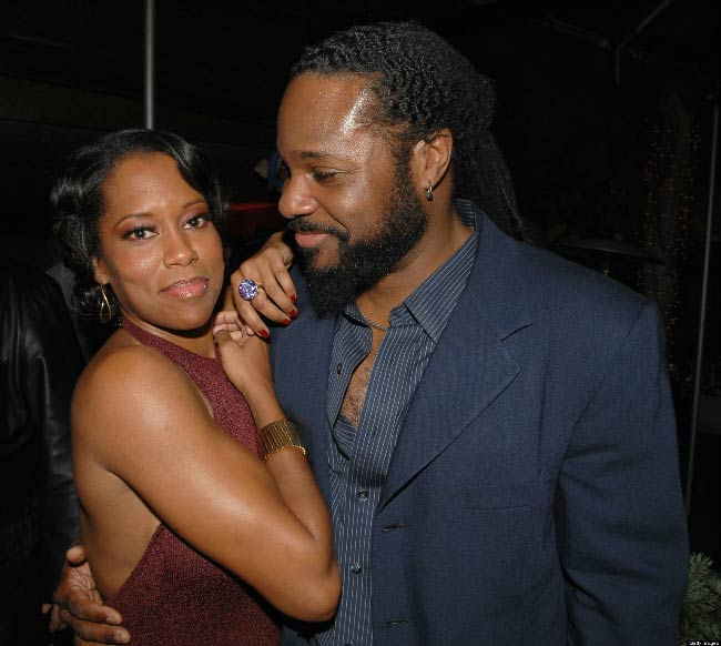 Regina King and Malcolm-Jamal Warner at a public event in 2013