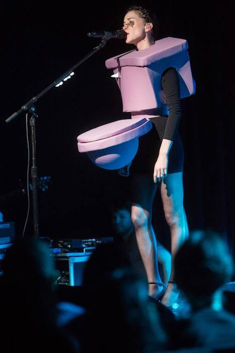 St Vincent wearing a toilet costume while giving performance at a Charity Concert at Le Poisson Rouge in New York in 2016