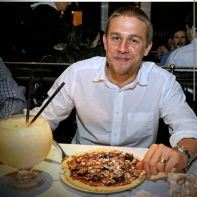 Charlie Hunnam having a treat meal