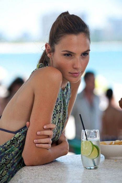 Gal Gadot with a lemon drink