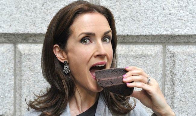 Maia Dunphy having a piece of chocolate cake