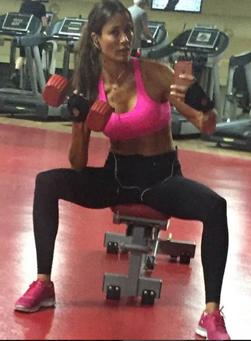 Melanie Sykes doing bicep curls in the gym