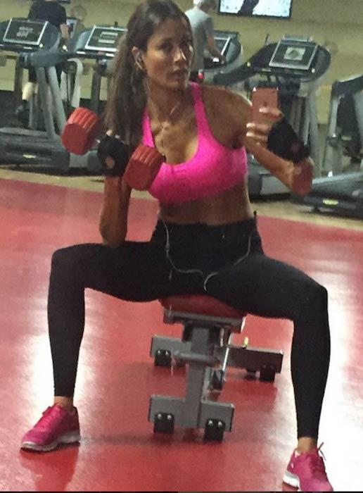 Melanie Sykes doing bicep curls in the gym