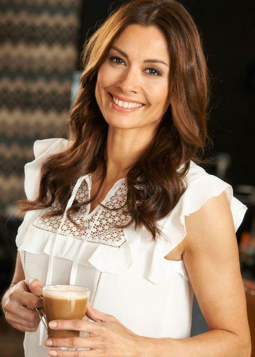 Melanie Sykes drinking coffee