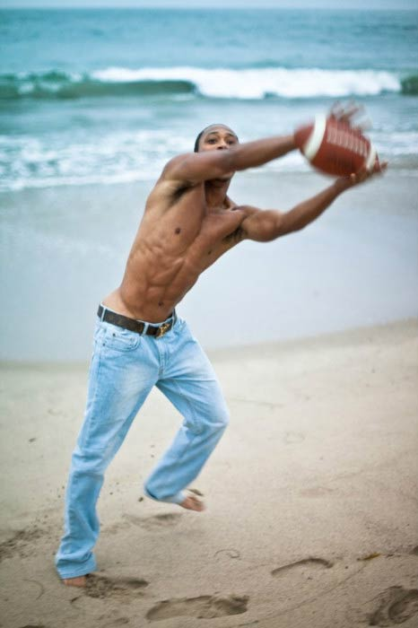 Romeo Miller shirtless in a beach photoshoot done in 2015