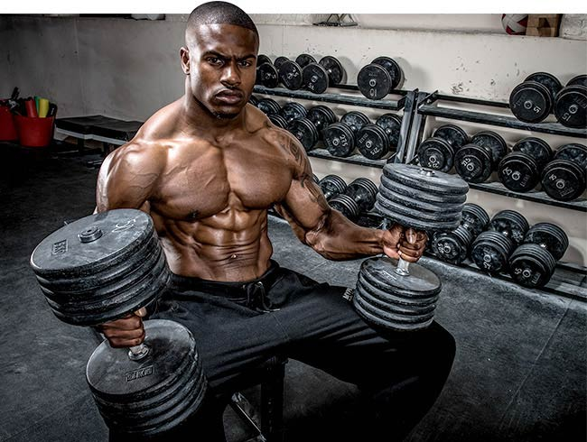Simeon Panda preparing to workout his chest