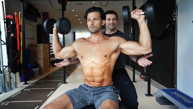 Tim Robards doing shoulder press exercise