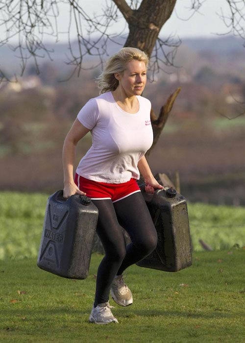 Abi Titmuss carrying weights at a park in London