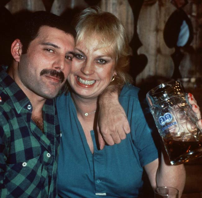 Freddie Mercury and Barbara Valentin poses in a bar