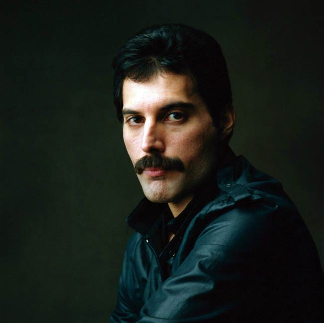 Freddie Mercury poses for a modeling photoshoot