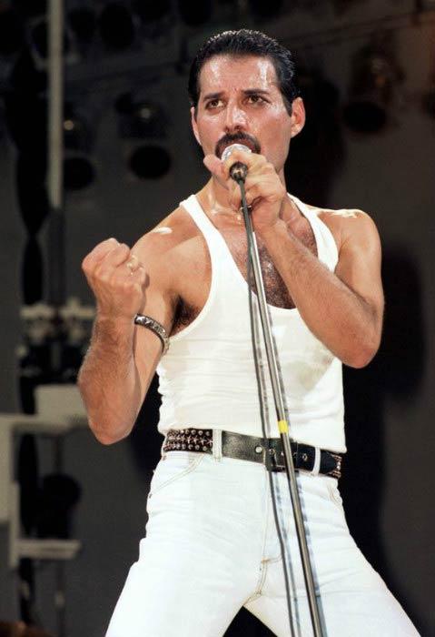 Freddie Mercury while performing on stage in 80's