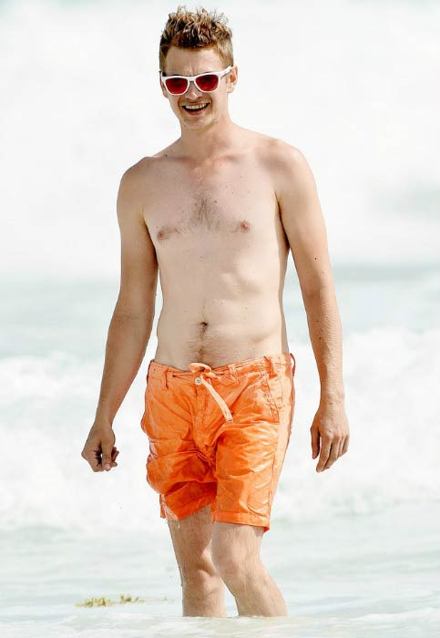 Hayden Christensen shirtless on the beach in Barbados in July 2014
