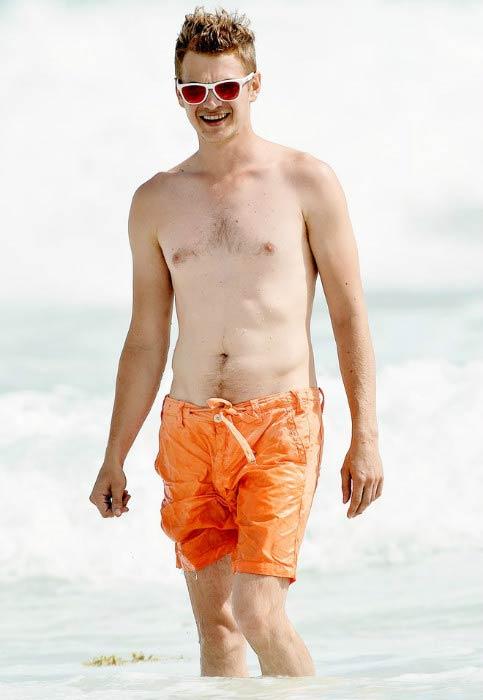 Hayden Christensen shirtless on the beach in Barbados in July 2014
