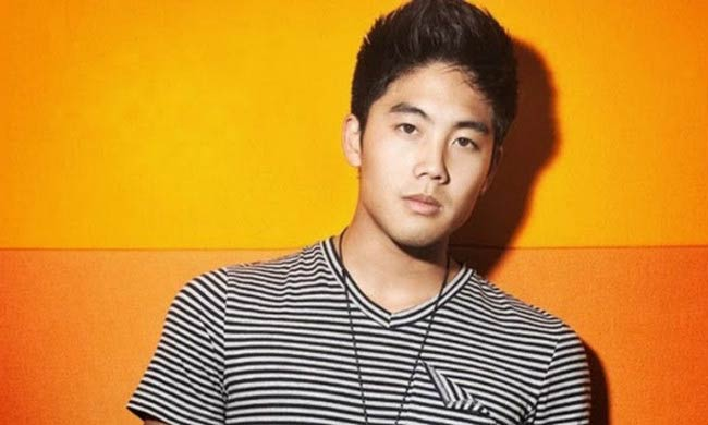 Ryan Higa poses for a modeling photoshoot done in 2014