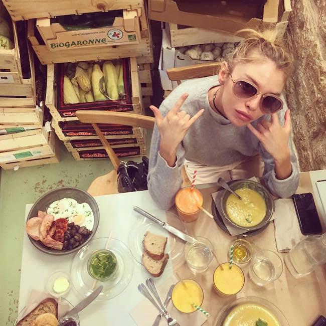 Stella Maxwell in the restaurant