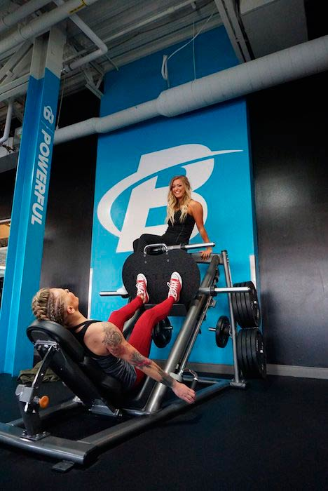 Allie Ruby while doing legs on a leg press machine
