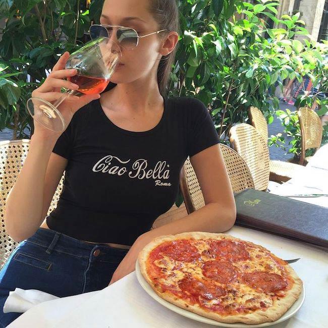 Bella Hadid having pizza