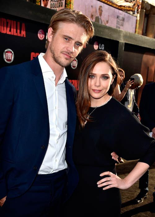 Boyd Holbrook with former girlfriend Elizabeth Olsen during the Godzilla Premiere in Hollywood, California on May 8, 2014