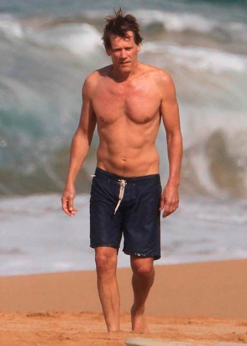 Kevin Bacon shirtless at the beach in Hawaii in January 2012