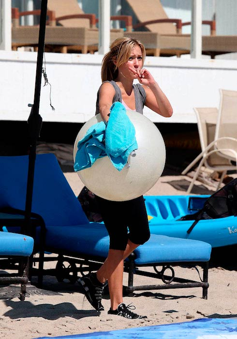 Kristin Cavallari with ball during a beach workout