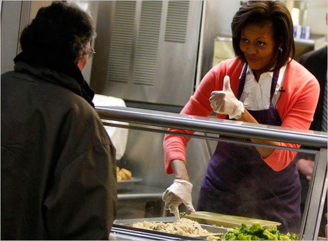 Michelle Obama serving food