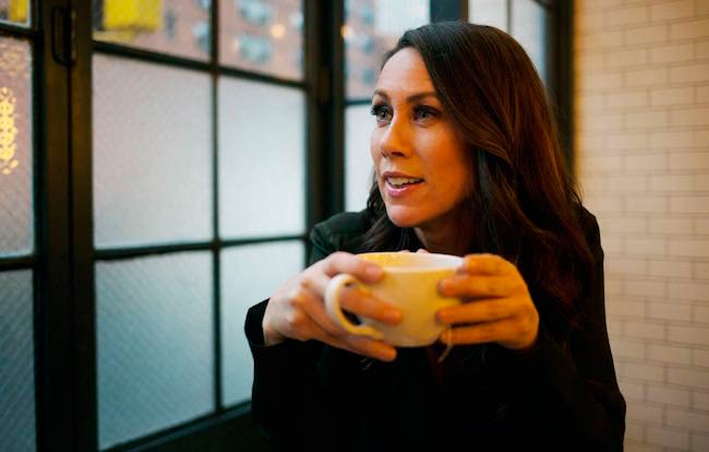 Miriam Shor drinking coffee