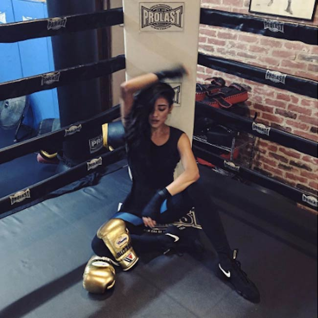Shay Mitchell in a boxing ring