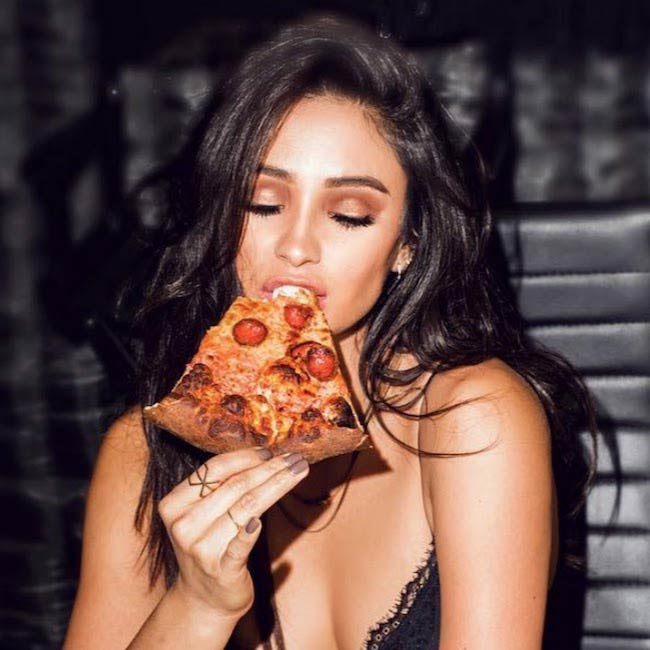 Shay Mitchell relishing pizza
