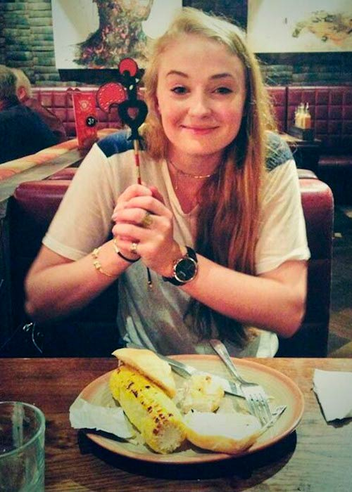 Sophie Turner posing before eating corn