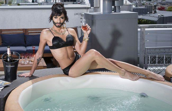 Tom, besides the Jacuzzi in his top floor apartment in Vienna, decked up as Conchita for a photoshoot in May 2014