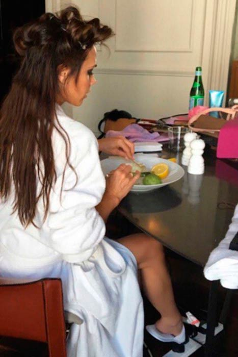 Victoria Beckham having fruits while getting her hair done