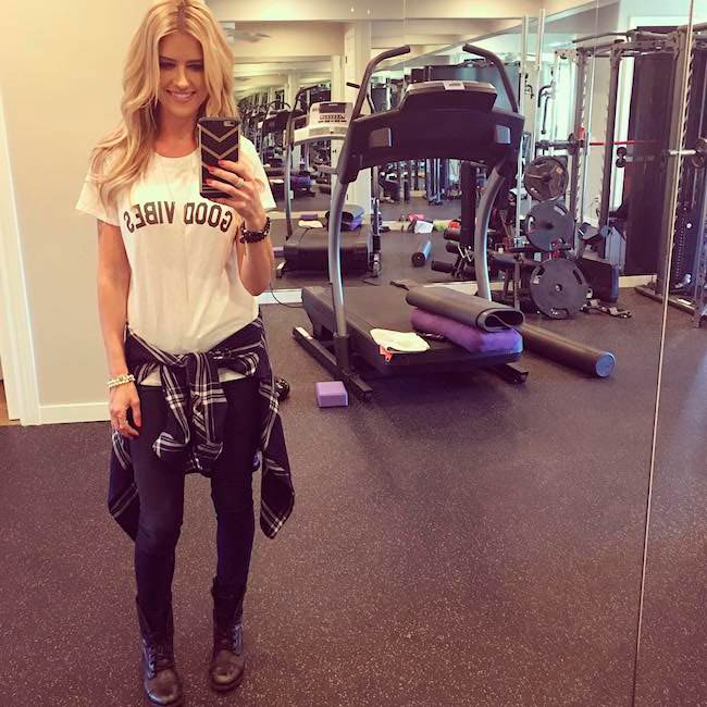 Christina El Moussa wearing her favorite outfit - denim, tee and boots