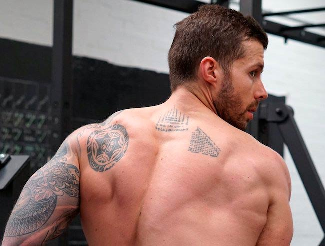 David Kingsbury showing his back muscles