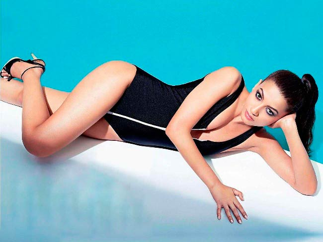 Gauhar Khan poses for a swimsuit modeling photoshoot in 2014