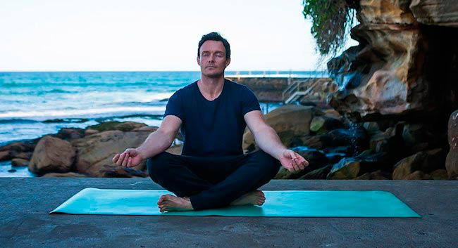 James Duigan doing yoga seaside