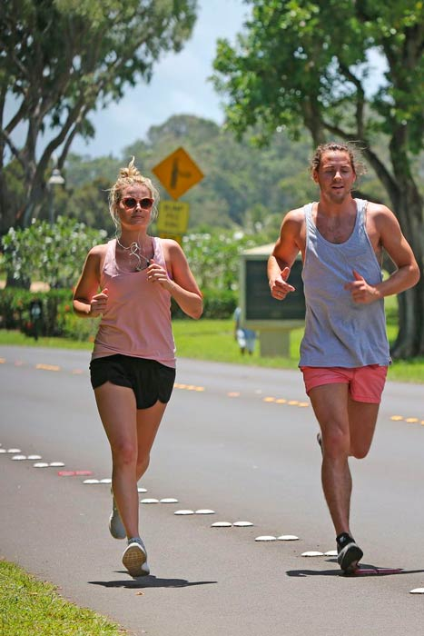 Margot Robbie running outdoors with her partner