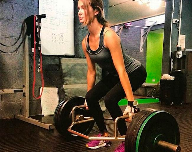 Millie Mackintosh doing deadlift during an intense gym workout
