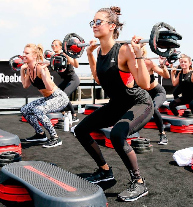 Nina Dobrev doing weighted squats