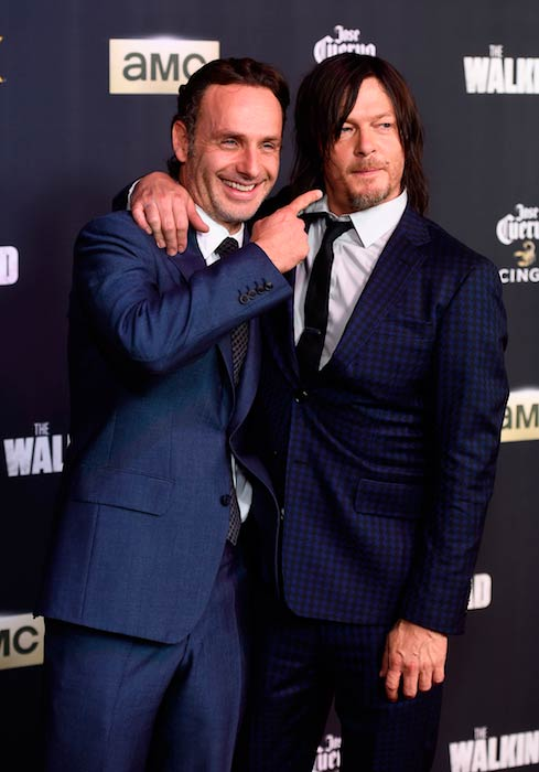 Norman Reedus with co-star Andrew Lincoln at the season 5 premiere party of The Walking Dead in Los Angeles in October 2014