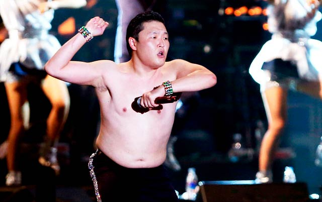 Psy shirtless while giving a performance in 2012